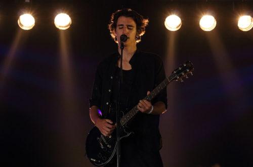 Tamino performing live on stage